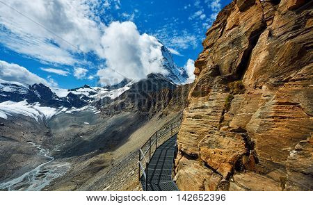 Snow capped mountains. Matterhorn mount in the clouds. view of the north- eastern ridge . Trek near Matterhorn mount.