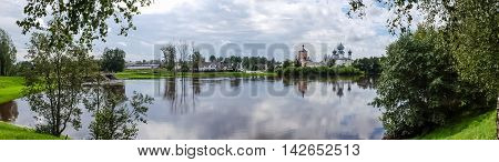 Panorama Tikhvin assumption male monastery, it is the Tikhvin icon of the mother of God. The Orthodox Church of Russia. The temple on the banks of the Tikhvinka river in Tikhvin.