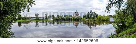 Panorama of Tikhvin assumption male monastery, it is the Tikhvin icon of the mother of God. The Orthodox Church of Russia. The temple on the banks of the Tikhvinka river in Tikhvin.