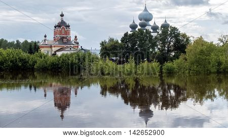 Panorama of Tikhvin assumption male monastery, it is the Tikhvin icon mother of God. The Orthodox Church of Russia. The temple on the banks of the Tikhvinka river in Tikhvin.