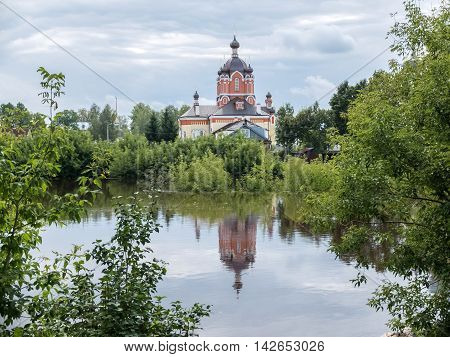 Tikhvin assumption male monastery. Orthodox Church of Russia. The temple on the banks of the Tikhvinka river in Tikhvin. Tikhvin icon of the mother of God.