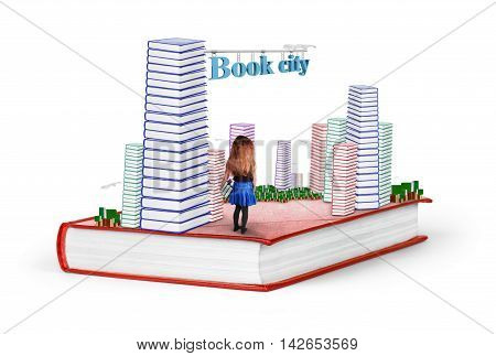 Book a city on an isolated background. The concept of the pursuit of knowledge the girl fell into fantasy.