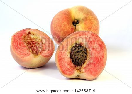 Ripe Japanese white peach fruits with sliced on white background.