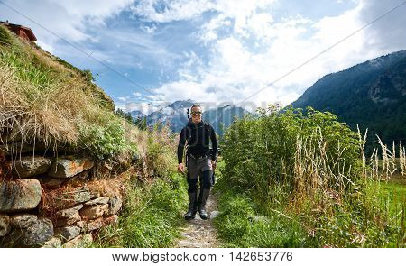 hiker on the trail in the Apls mountains. Trek near Matterhorn mount