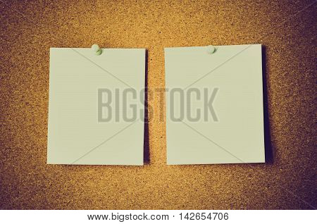 blank note papers on a cork board