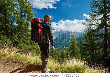 hiker in the Apls mountains. Trek near Matterhorn mount