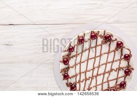 Chocolate cake with mousse decorated with cherries and chocolate. Copyspace