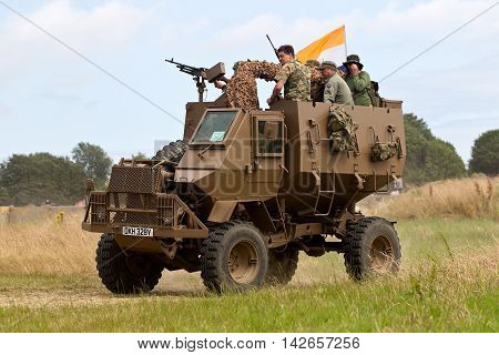 WESTERNHANGER, UK - JULY 22: An ex RSA army armoured vehicle gives a demonstration to the watching public in the main show arena at the War & Peace show on July 22, 2015 in Westernhanger