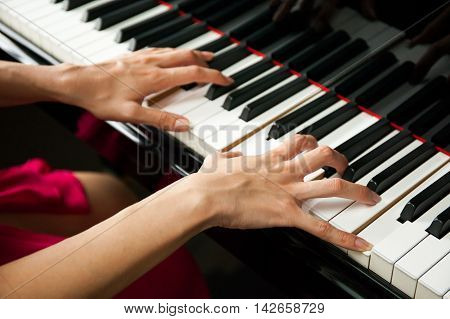 Close-up Of Woman Hands Playing Piano