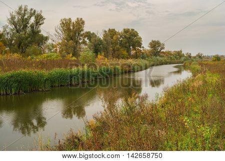 Autumnal Ukrainian landscape with small river Sura