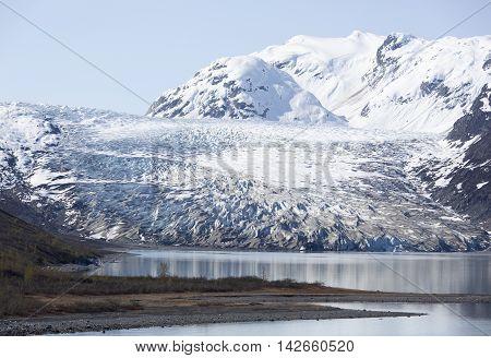 The beach of wilderness next to the glacier in Glacier Bay national park (Alaska).