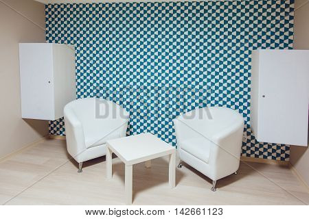 The room interior, table and stools wite