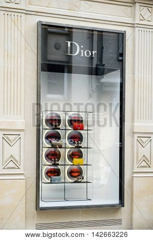 LUXEMBOURG LUXEMBOURG - JUN 05 2016: People admiring luxury fashion DIOR store in central Luxembourg on 16 Rue Philippe II