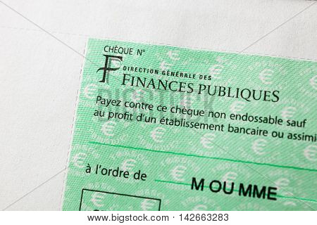 PARIS FRANCE - JAN 14 2016: Detail of French Cheque issued by the Direction Generale des Finances Publiques - the division f Economic Minister responsible for income taxes