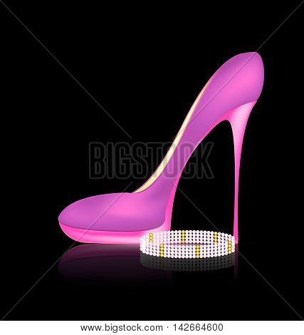 dark background and the pink ladys shoe with beads braselet