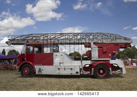 POTTEN END, UK - JULY 27: A preserved vintage fire engine enters the show arena to give a public display at the Dacorum Steam Fair on July 27, 2014 in Potten End.