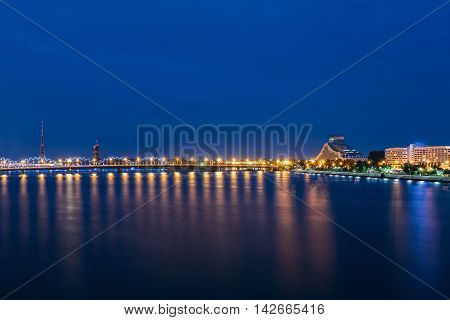 Night Cityscape Of Riga, Latvia. View On The National Library Of Latvia. Riga Radio Tv Tower. Seafront. Copyspace. Travel Destination. Nobody.