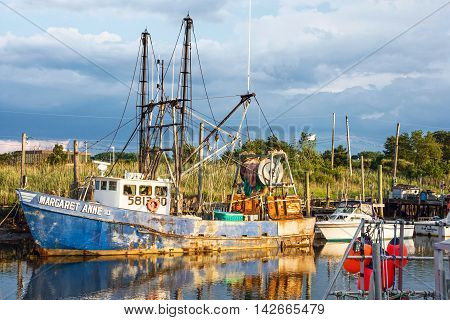 MIDDLETOWN NEW JERSEY- AUGUST 6 - Commercial fishing boat on Shoal Harbor on August 6 2016 in Middletown NJ.