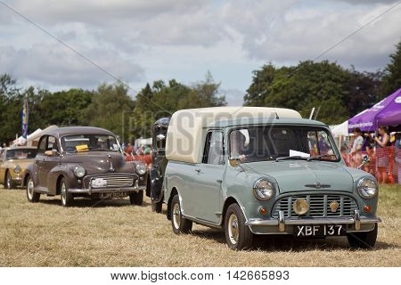 POTTEN END, UK - JULY 27: A vintage British Leyland Mini commercial van is paraded around the main arena for the public to view at the Dacorum Steam & Country fair on July 27, 2014 in Potten End