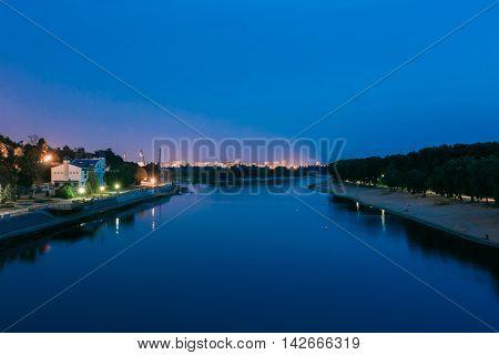 Night View Of Sozh River, Sand Beach, Lighted Embankment In Gomel, Homiel, Belarus. Summer Evening Night Blue Sky, Uptown Background