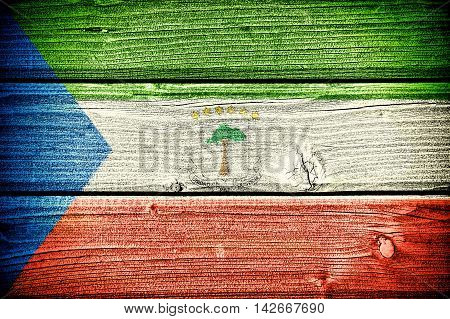 flag of Equatorial Guinea painted on old grungy wooden background: 3d illustration