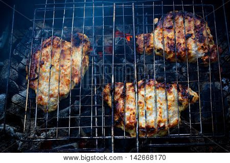 Pork covered by sause on grill cooked for summer family dinner
