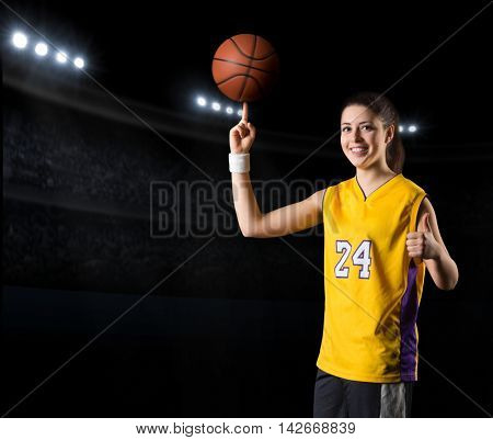 Young girl basketball player at sports hall