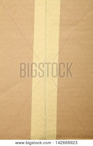 Cardboard box sealed with adhesive tape for background