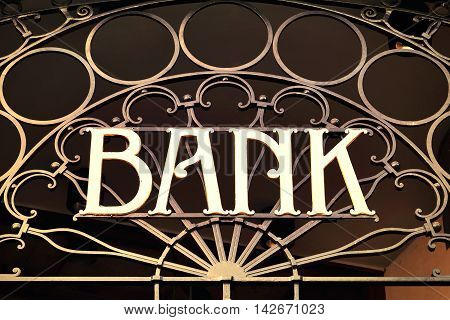 Old fashioned bank sign, building exterior of a bank with wrought iron.