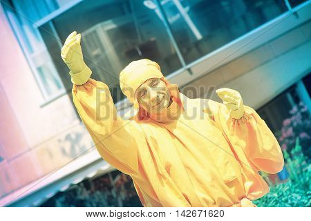 AVIGNON, FRANCE - JULY 05, 2015: actor wearing a yellow costume advertising thisr performance at the street during famous theatre festival from July 3 to 26, 2015 in Avignon south of France.