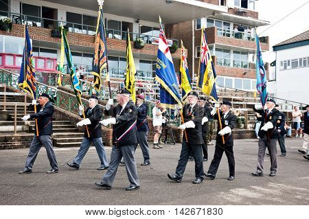WESTERNHANGER, UK - JULY 19: Members of the Royal British Legion parade in front of the main grandstand for a remembrance service to fallen servicemen at the W&P show on July 19, 2014 in Westernhanger