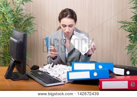 Busy businesswoman in the office under stress