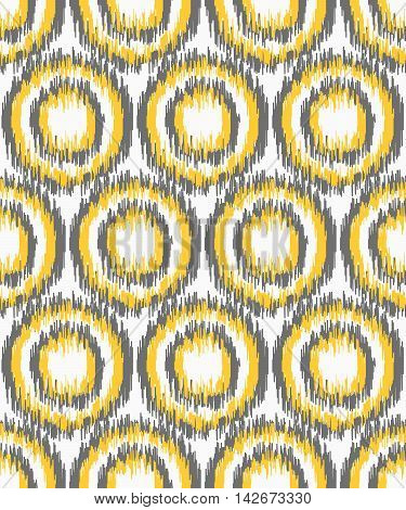 Seamless geometric pattern, based on ikat fabric style. Vector illustration. Gray and yellow upholstering fabric. Circle patterns.