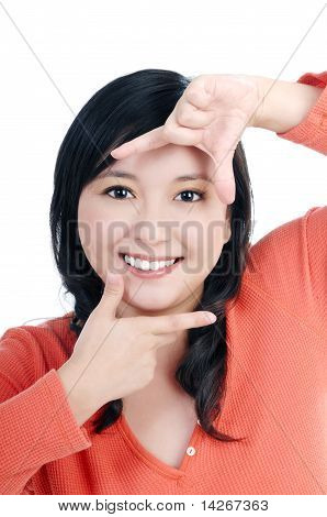 Beautiful Young Woman Showing Picture Frame With Her Fingers
