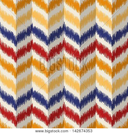 Seamless geometric pattern, based on ikat fabric style. Vector illustration. Chevron rug pattern. Colorful zig-zag pattern. Yellow, orange and red herringbone pattern.