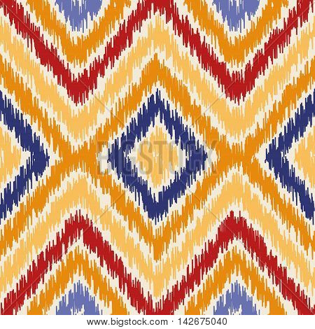 Seamless geometric pattern, based on ikat fabric style. Vector illustration. Oriental rug pattern, in yellow, orange and red. Colorful chevron pattern.