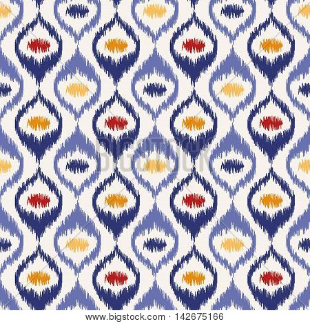 Seamless geometric pattern, based on ikat fabric style. Vector illustration. Oriental rug pattern, in yellow, orange and red. Blue ogee pattern.