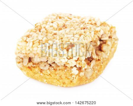 oriental sweets with sesame and sunflower seeds, isolated on white