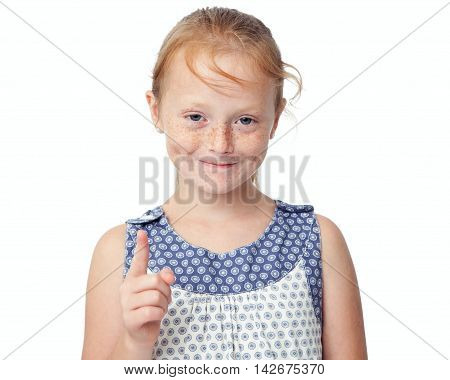 Close up little ginger girl wagging the finger at the camera and smiling isolated on white background