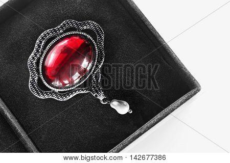 Vintage ruby silver brooch in black jewel box