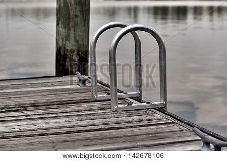 Aluminum Step Ladder On Side Of Pier
