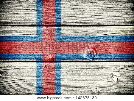 flag of the Faroe Islands painted on old grungy wooden background: 3d illustration