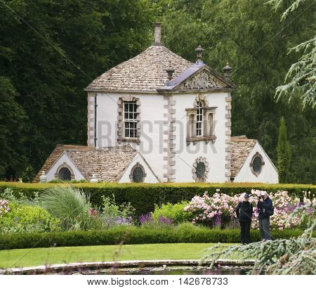 CONWY, WALES, JUNE 27. Bodnant Garden on June 27, 2016, near Conwy, Wales. Visitors to Bodnant Garden near Conwy Wales enjoy the Garden Lily Pond and Terrace.