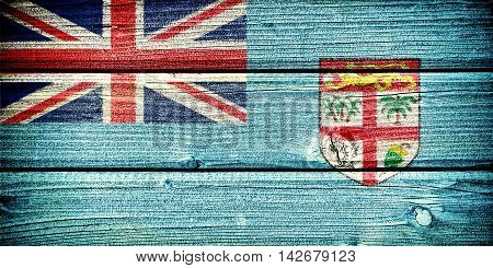flag of Fiji painted on old grungy wooden background:  3d illustration