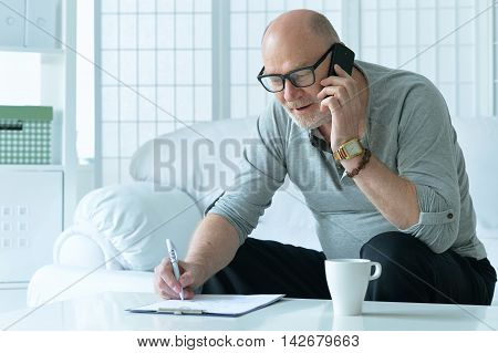 Portrait of a senior man with phone