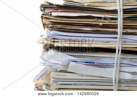 Old newspapers, magazines prepared for recycle. Isolated on white background.