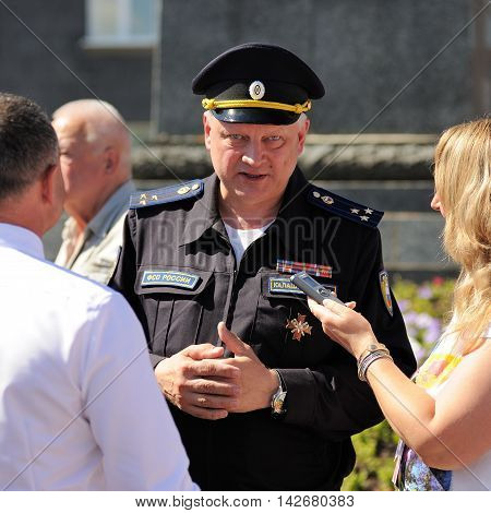 Orel Russia - August 05 2016: Orel city day. Sergey Kalashkinov colonel of FSO giving interview closeup