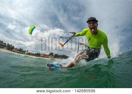 Crazy kite surfer rides the waves