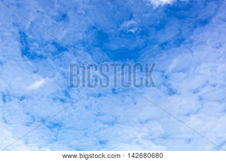Blue sky with cirrus clouds on a sunny day.