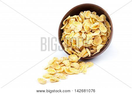 Cornflakes in a wooden bowl isolated on white background.